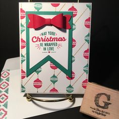 WRAPPED IN WARMTH from the 2016 holiday catalog. Card stock is Whisper White THICK, Emerald Envy and Real Red. DSP stamped with set, using SAMJ & added Delightful Dijon ink. Banners Framelits. Bow Builder Punch. All supplies & images by Stampin'Up!