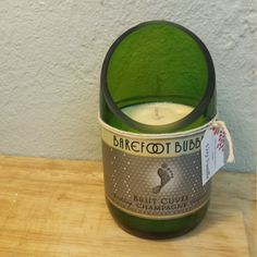 Champagne bottle with a custom slant-cut turned into a scented soy wax candle. Filled with Very Vanilla scented wax. $20