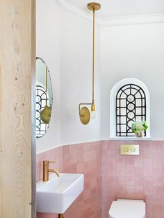 architect Penny Kinsella and interior designer Susie Cohen (Made by Cohen) both credit their united front when it came to the successful transformation of this large, disjointed Melbourne residence into a bright, elegant and refined family home. Pink Bathroom Tiles, Pink Tiles, White Bathroom, Pink Bathroom Vintage, Kmart Bathroom, Pink Bathrooms, 1950s Bathroom, Mirror Bathroom, Bathroom Faucets