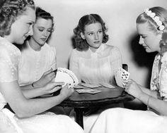 Rosemary Lane, Gale Page, Lola Lane, and Priscilla Lane play bridge.