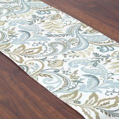Linen-blend table runner with a floral damask motif.   Product: RunnerConstruction Material: 55% Linen and 45% ra...