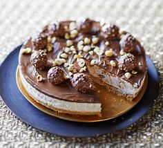 Chocolate Hazelnut Cheesecake Topped With Fererro Rochers! I Don't Like Cheesecake To Eat (I'm Weird) But I Love Making It As A Special Dessert For Parties Or Anniversaries! Hazelnut Cheesecake Recipe, Ferrero Rocher Cheesecake, Nutella Cheesecake, Cheesecake Recipes, Dessert Recipes, Cheesecake Cake, Chocolate Hazelnut, Chocolate Desserts, Bbc Good Food Recipes