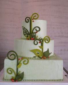 Sage green-tinted Italian meringue buttercream covers this autumnal wedding cake