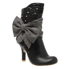 Irregular Choice Rosie Lea. Anyone fancy a Rosie Lea.... this lovely boot comes in a black coloured leather with polka dot trim. There is a pretty tweed sash that wraps around your ankle securing in a big bow at the side. There is a zip on the inside of the boot.