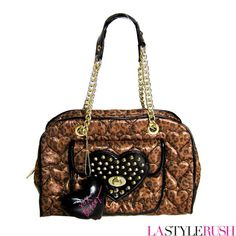 Super big sale on Betseyville by Betsey Johnson Be Mine Again Satchel Bag in Cheetah at LAStyleRush.com ! This Betseyville by Betsey Johnson satchel shows off your cute style and works with every look. On a quilted heart printed metallic cheetah background, it features a studded heart at the front and iconic double chain handles. Hurry and get them before they're gone!