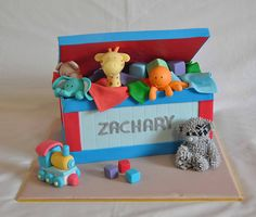 Toybox and toys first birthday cake