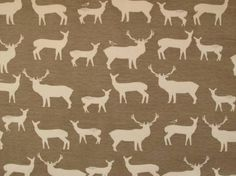 Stunning organic jersey knit fabric with all over elk repeat design.  100% Cotton  112cm wide  All of our dress fabrics are sold by the metre simply add the number required into the box then click add to shopping bag