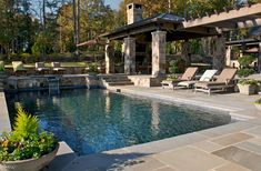 So beautiful and tranquil. Love the transition from pergola to solid roof, use of stone and flagstone (by Kemp Hall Studio)