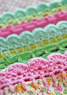 Am thinking could make all those non-girly wraps/muslins a little girly with a crochet edge in pink or other girly shade...  Crocheted edging for baby blankets and other textiles