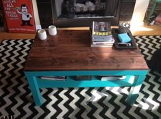 Maybe paint the legs of the existing coffee table  in Benjamin Moore Calypso Blue