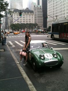 Austin Healey Sprite on it's first assignment. Certainly glamorous surroundings for a little car!!