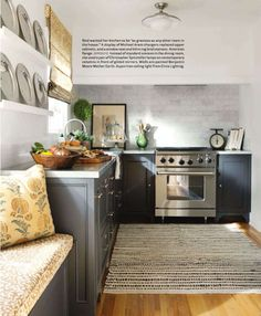 that built in seat is just what i need in my new kitchen ... i love when people have somewhere comfy to sit and talk with you while you are in the kitchen busy .. nice cabinet colour too, but you knew i'd say that!