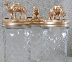 Animal Jars; $25.60 on uncovet.com.  Also an easy DIY project with some mason jars, spray paint and some animal toys from the store
