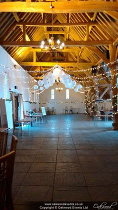 Star of fairy lights with white and lace paper lanterns at Ufton Court