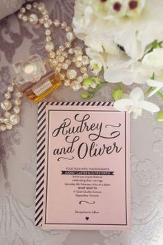pink black and white wedding invite with Lisa's favorite black and white flowers and pearls for table
