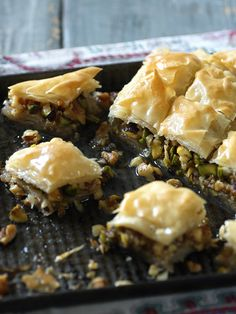 Sticky sweet, flaky and nutty, a small slice of baklava goes a long way, especially with a tiny cup of strong coffee. Serve after a mezze feast. Chocolate Baklava, Baklava Recipe, Greek Recipes, Greek Desserts, Tray Bakes, Cookies Et Biscuits, Sweet Tooth, Sweet Treats, Cooking Recipes