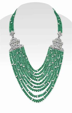 AN EMERALD BEAD AND DIAMOND NECKLACE The front designed as a multi-strand emerald bead swag, spaced by circular-cut diamond rondelles, intersected by two baguette and circular-cut diamond openwork plaques, to the three-strand emerald bead neckchain, joined by an openwork circular-cut diamond plaque clasp, mounted in white gold, 16½ ins.