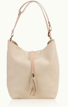 White with tassel hobo style bag