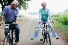 Stock Photo : Man and woman riding bicycles