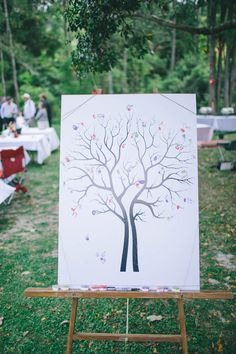 Thumbprint tree guest book; love how two trees merge into one