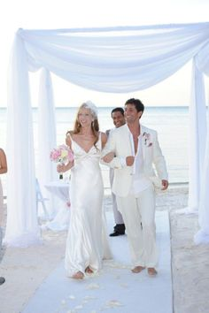 all white pergola on the beach are you thinking about a wedding in the Bahamas email us @infinitytravelandvacation@gmail.com
