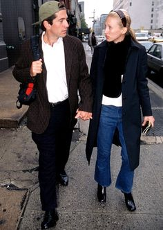 John F Kennedy Jr and his wife Carolyn Bessette walk to the subway after leaving their Tribeca loft on N Moore St, New York, New York, October (Photo by Allan Tannenbaum/Getty Images) John Kennedy Jr, Carolyn Bessette Kennedy, Jfk Jr, Les Kennedy, Caroline Kennedy, Five Jeans, Calvin Klein, Jeans Denim, Sarah Jessica Parker