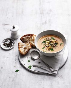 A whole bulb of roasted garlic adds incredible flavour to this smooth, cheesy soup and the topping of roasted cauliflower and stilton takes this simple lunch to a new level.