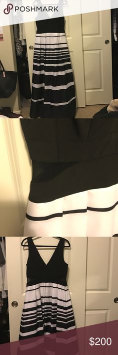 Black and White Striped Formal Dress w/ sheer Black and White Striped Formal Dress w/ sheer cut outs. Only worn once. In very good condition. Xscape Dresses
