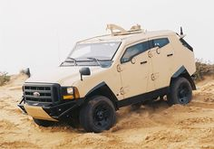 Plasan Sand Cat (customized Ford F-series chassis) Small Ford Trucks, Big Trucks, Cat Armor, Sand Cat, Amphibious Vehicle, Armored Truck, Terrain Vehicle, Bug Out Vehicle, Ford F Series