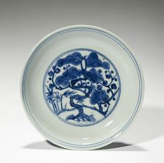 Plate with the Three Friends of Winter, Ming dynasty (1368-1644), Jiajing six-character mark and of the period (1522-1566), China. Porcelain with underglaze blue decoration. H. 1 in x Diam. 5 3/4 in, H. 2.5 cm x Diam. 14.6 cm. The Avery Brundage Collection, B60P2359. © 2016 Asian Art Museum Chong-Moon Lee Center for Asian Art and Culture