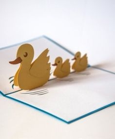 Mother's Day pop up card in blue and white paper with three yellow ducks