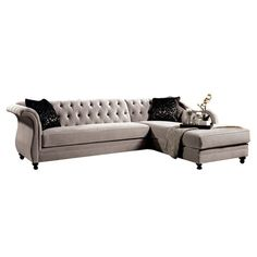 Glam up your formal living room or parlor with this regal sectional sofa, featuring stylish tufted upholstery and crystal-inspired button accents.