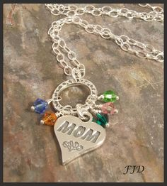 A perfect gift for your mom!  The crystals represent birthstones of children