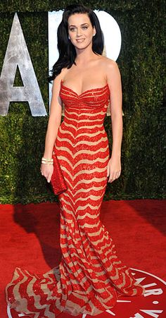 Katy Perry's  In a dazzling red and tan-striped Zuhair Murad Couture gown at the 2010 Vanity Fair Oscar Party in West Hollywood.