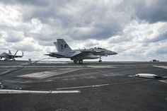 An EA-18G Growler assigned to the Zappers of Electronic Attack Squadron (VAQ) 130 lands on the flight deck of the aircraft carrier USS Dwight D. Eisenhower (CVN 69), the flagship of the Eisenhower Carrier Strike Group.