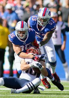 ORCHARD PARK, NY - SEPTEMBER 08: Danny Amendola #80 of the New England Patriots is tackled by Zach Brown #35 and Nigel Bradham #53 of the Buffalo Bills at Ralph Wilson Stadium on September 8, 2013 in Orchard Park, New York.New England won 23-21. (Photo by Rick Stewart/Getty Images)