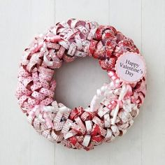 Paper Curls Valentine Wreath  A wreath covered with paper curls bursts with Valentine's Day color and spirit. Lovely over a mantel or on a by emily