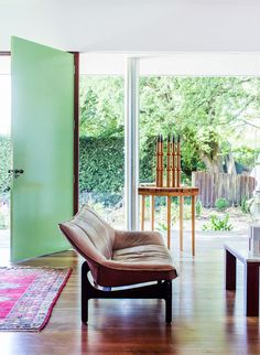 mint green on a dramatically oversized door in Peter and Helen Cole's Custom Built Residence | Trendland