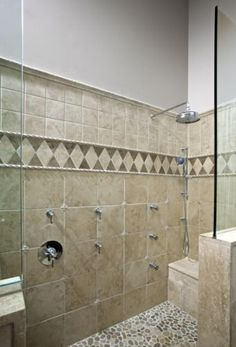An intricate custom designed tile layout was incorporated into the shower giving the shower area a very opulent look and feel. Done by HTRenovations - Philadelphia/Bucks County Bathroom Renovations Design Redesign