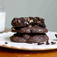 Thick and gooey triple chocolate brownie cookies with semi-sweet chunks, milk and white chips, and walnuts.