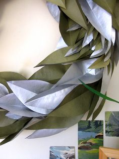Paper leaves: Spray paint one side of hardware-store masking paper with shine to give leaves dimension. @Marie Webster