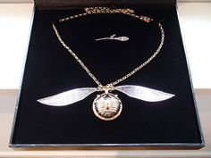 About this time last year, I was contacted by a customer who wanted to make that special moment an extra special surprise – this piece of Harry Potter inspired art was commissioned. Made out of Sterling Silver, the Snitch had an extra thick coating of 18ct Yellow Gold, with the wings likewise plated in an extra thick coating of Rhodium. Made to be a necklace pendant, I made a Nimbus 2000 Broomstick Charm to accompany it that unbeknownst to everyone else, is the Key to open it.