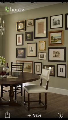 Love the wall color and mix of frames