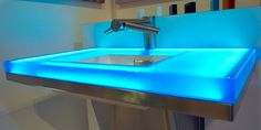 Neo-Metro translucen resin glowing sink with Dyson Airblade Tap
