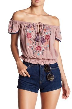 Nothing says festival season quite like this embroidered off-the-shoulder blouse.