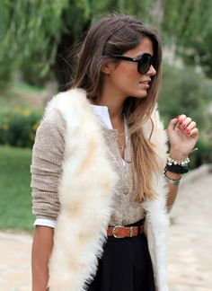 fur vest layered over neutral covered cardigan