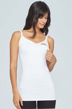cf6cea9cc1 This patented 3-panel nursing tank is a true mother s helper. Featuring our  signature