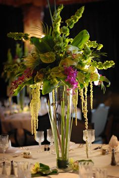 really like the greens and hint of hot pink and the fiddlehead ferns in the pilsner vase