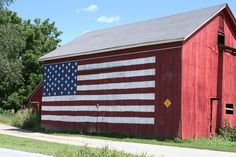 American Flag on an old red barn <3