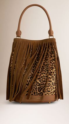 Honey/dark sand The Bucket Bag in Animal Print Shearling And Fringing - Image 1 Leather Purses, Leather Bag, Handbag Accessories, Fashion Accessories, Animal Print Fashion, Animal Prints, Fringe Bags, Boho Bags, Mode Style